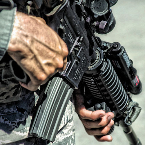Assault rifle in the hands of a military man